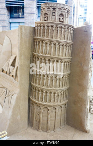 Lonley Planet use sand castle featuring Italy's Pisa to promote their new book called 'Ultimate Travelist'. - Stock Photo