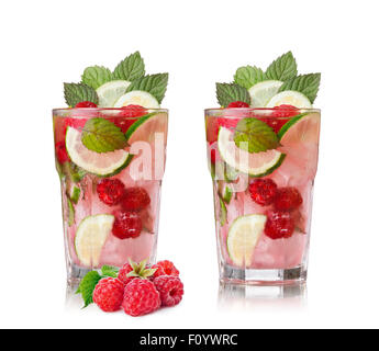 Raspberry mojito. Refreshing alcoholic cocktail with raspberries,lime,rum and mint - Stock Photo