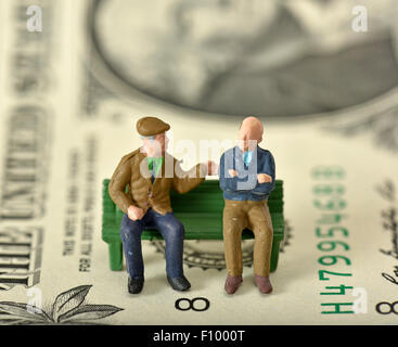 Pensioners on a bench, dollar bill behind, symbolic image for pension, private and state pension - Stock Photo