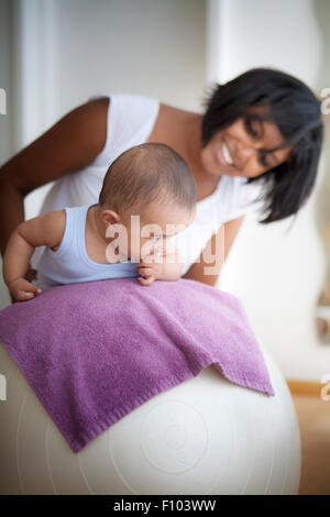INFANT BEING MASSAGED - Stock Photo