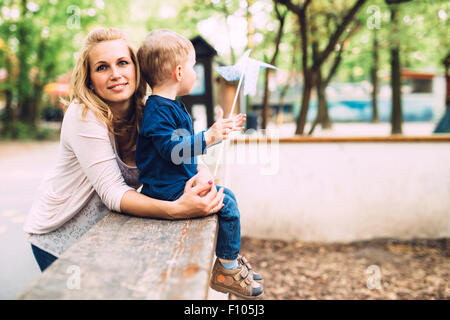 Mother having a good time with her son outdoor - Stock Photo