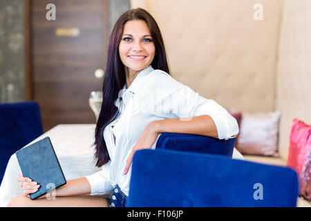 Portrait of a white beautiful woman smiling outdoors - Stock Photo