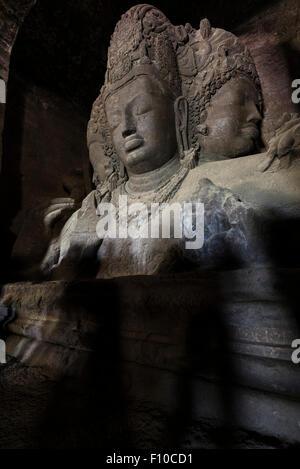 Trimurti of Brahma, Vishnu, and Shiva in the Great Cave on Elaphanta Island, Maharashtra, India - Stock Photo