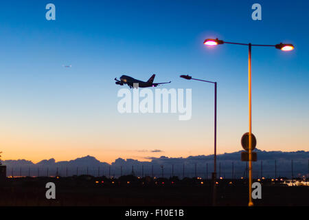 A Boeing 747 takes off from London's Heathrow Airport. - Stock Photo