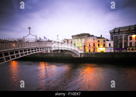 Ha'Penny Bridge over the River Liffey in Dublin Ireland with vintage filter effect - Stock Photo