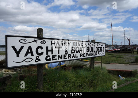 Harry King boatyard Pin Mill on river Orwell hand lettered sign - Stock Photo
