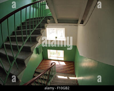 The interior staircase between floors in high-rise building with wide angle fisheye lens and distortion view - Stock Photo