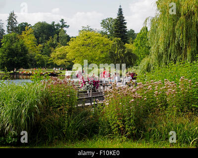 The Casino Gardens around the lake in Bagnoles-de-l'Orne, Nroamdy, France - Stock Photo