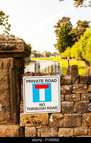Private road no through road sign on wall drive driveway North Yorkshire UK England - Stock Photo