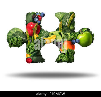 Healthy food solution and eating fresh fruits and vegetables symbol as raw produce shaped as a puzzle piece on a - Stock Photo