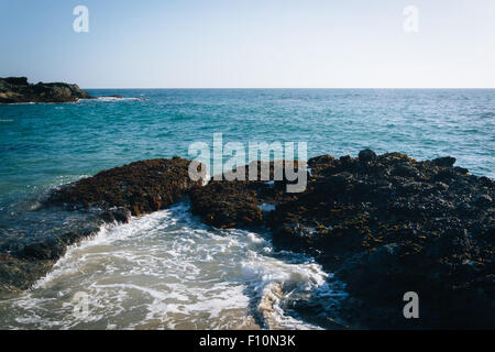 View of rocks in the Pacific Ocean from Table Rock Beach in Laguna Beach, California. - Stock Photo
