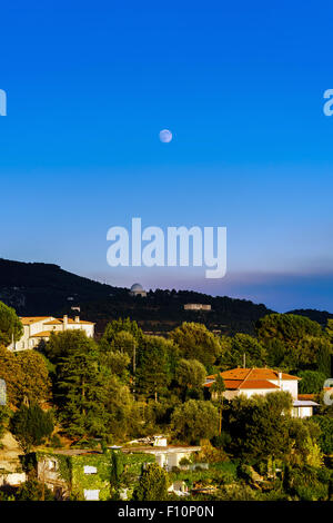 Modern villas in Nice view, sunset, summer, cypress and palms, France - Stock Photo