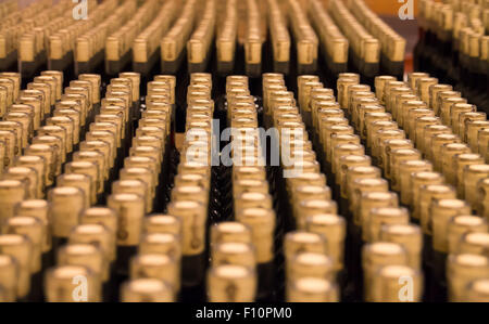 A large stack of bottles of wine, ready to be labeled. - Stock Photo