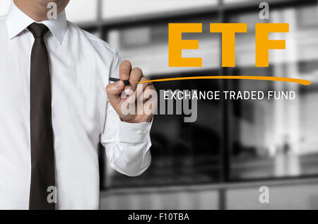 ETF is written by businessman background concept. - Stock Photo