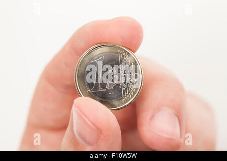 One Euro coin in hand