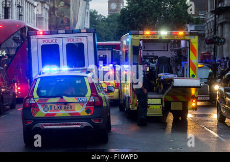 Multiple vehicles on scene of a an injured male in the middle of the road. - Stock Photo