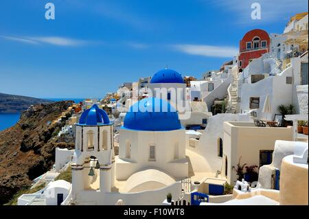 The iconic blue domed Churches on the island of Santorini,Greece - Stock Photo
