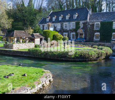 Swan Hotel on the River Coin in Bibury, the Cotswolds, Gloucestershire, England, UK - Stock Photo