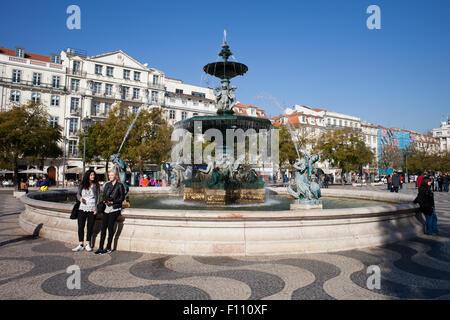 Fountain on Rossio Square in Lisbon, Portugal - Stock Photo