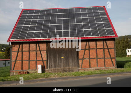 Solar PV roof on old half-timbered barn near Kassel Germany