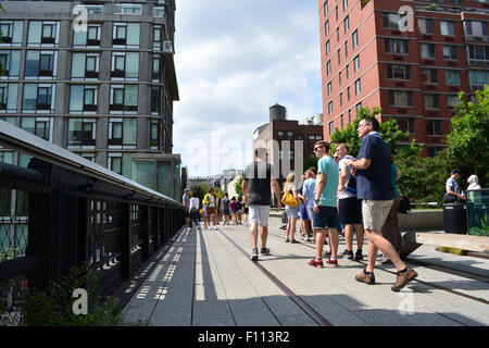 People walking along the High Line in Manhattan. - Stock Photo