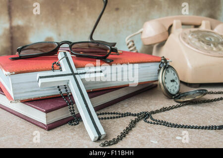 Cross and stationery on the desk. - Stock Photo