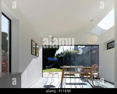 View from dining area towards garden. Bouverie Road, London, United Kingdom. Architect: ullmayer sylvester architects, - Stock Photo