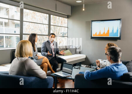Business people having meeting in office lounge - Stock Photo