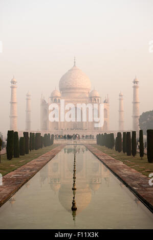 Agra, Uttar Pradesh, India. The Taj Mahal seen from the end of the al Hawd al-Kawthar tank, with its reflection, - Stock Photo