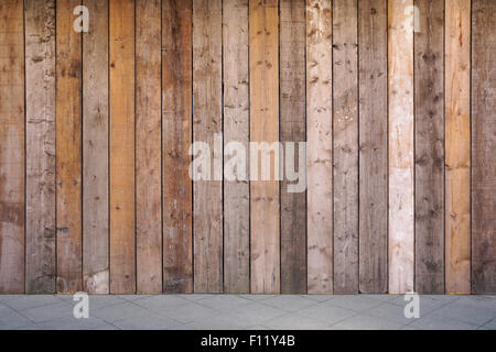 boarded up wall with weathered wooden planks - Stock Photo
