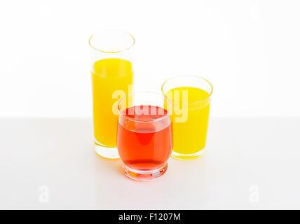 fresh fruit juices on white background - Stock Photo