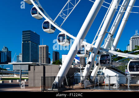 The Wheel of Brisbane in front of the skyline. - Stock Photo