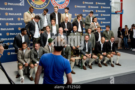 Munich, Germany. 25th Aug, 2015. The FC Bayern Munich team pose in traditional Bavarian costume during a photoshoot - Stock Photo