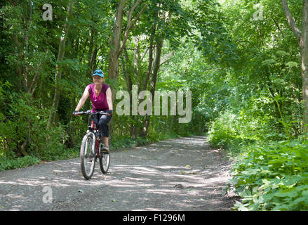 A female cyclist on National Cycle Network Route 45 in Shropshire, England. - Stock Photo