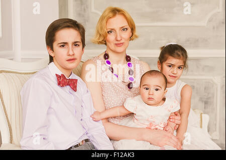 Caucasian woman with Arab children - Stock Photo