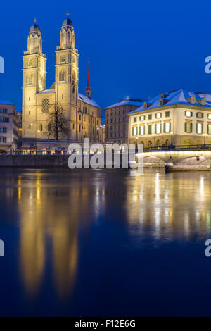 The Minster in Zurich illuminated at night - Stock Photo