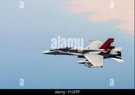 A U.S. Marine Corps F/A-18 fighter aircraft prepares to refuel from a Royal Canadian Air Force refueller during - Stock Photo