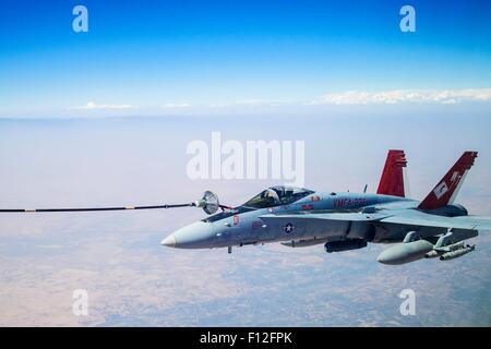 A U.S. Marine Corps F/A-18 fighter aircraft refuels from a Royal Canadian Air Force CC-150 Polaris refueller during - Stock Photo