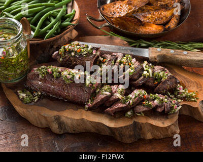 Onglet beef with chimichurri sauce - Stock Photo