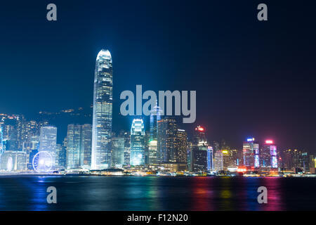 Nightview of Victoria Harbour in Hong Kong - Stock Photo