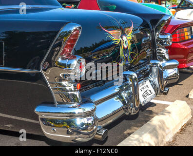 Rear view of a 1955 restored and customized Buick at a August, 2014 classic car show in Washington, State. - Stock Photo