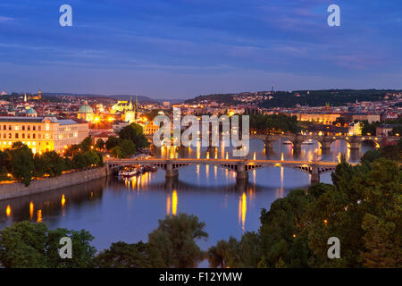 Bridges over the Vltava River in Prague, Czech Republic. Photographed from above at night. - Stock Photo