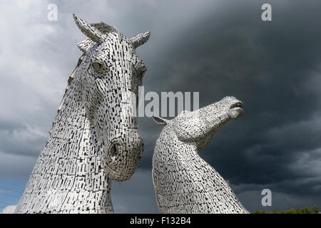 The Kelpies sculpture of two horses at entrance to the  Forth and Clyde Canal at The Helix Park near Falkirk, Scotland - Stock Photo