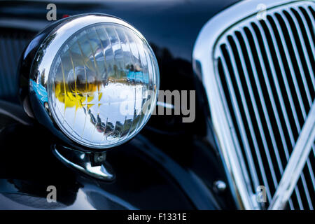 vintage car detail - headlamp grille - Stock Photo