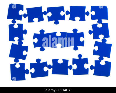 Jigsaw pieces on a white background - Stock Photo
