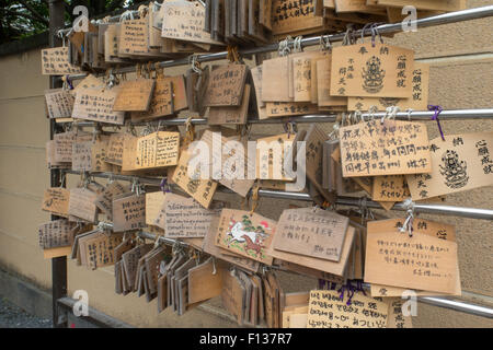 Ema wooden plaques at a Shinto Shrine - Stock Photo