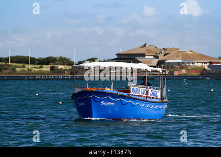 Southport, Merseyside, UK 26th August, 2015.  UK Weather. Lakeside activities in sunny but blustery conditions after - Stock Photo
