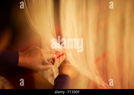 Weaver making silk cloth, Luang Prabang, Laos, March 2009. - Stock Photo