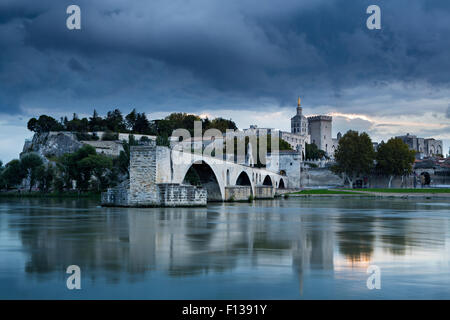 The Pont St-Benezet, Palais des Papes and Rhone River at dusk, Avignon, Provence, France, October 2012. - Stock Photo