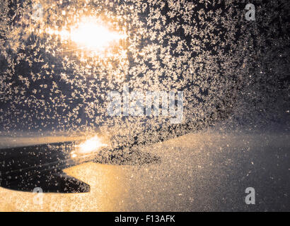 View out of frosted airplane window at sunset - Stock Photo